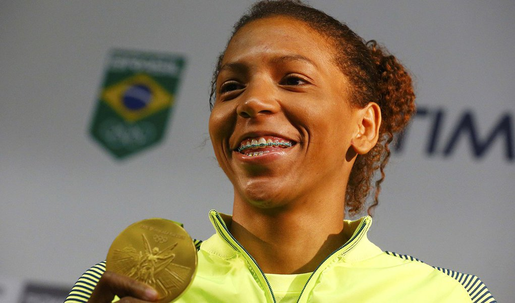 2016 Rio Olympics - Judo - Women - 57 kg - Rio de Janeiro, Brazil - 09/08/2016. Rafaela Silva holds her gold medal during a press conference. REUTERS/Nacho Doce Picture Supplied by Action Images