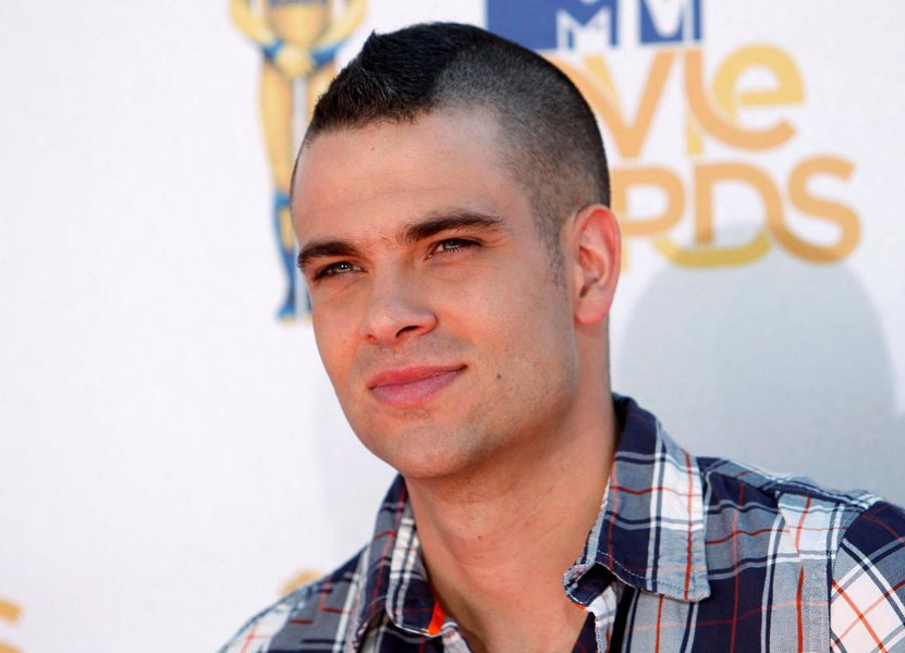 FILE PHOTO: Actor Mark Salling from the television show 'Glee' arrives at the 2010 MTV Movie Awards in Los Angeles, California, U.S. June 6, 2010. REUTERS/Danny Moloshok/File Photo