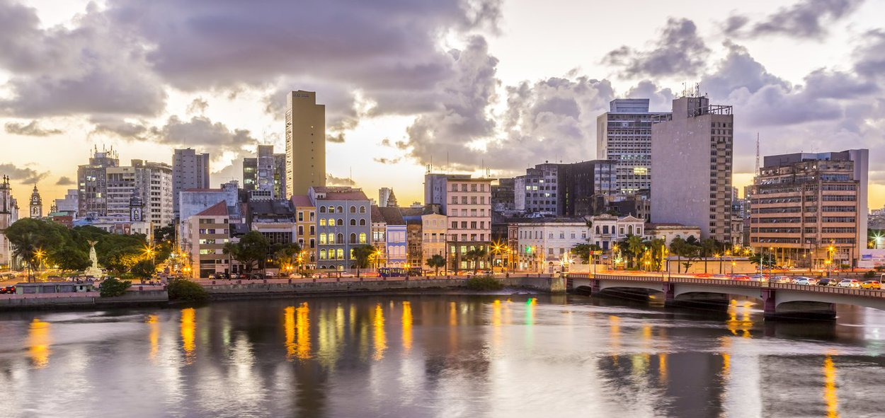 Skyline of Recife in Pernambuco, Brazil showcasing its historic architecture at sunset by the Capibaribe River.