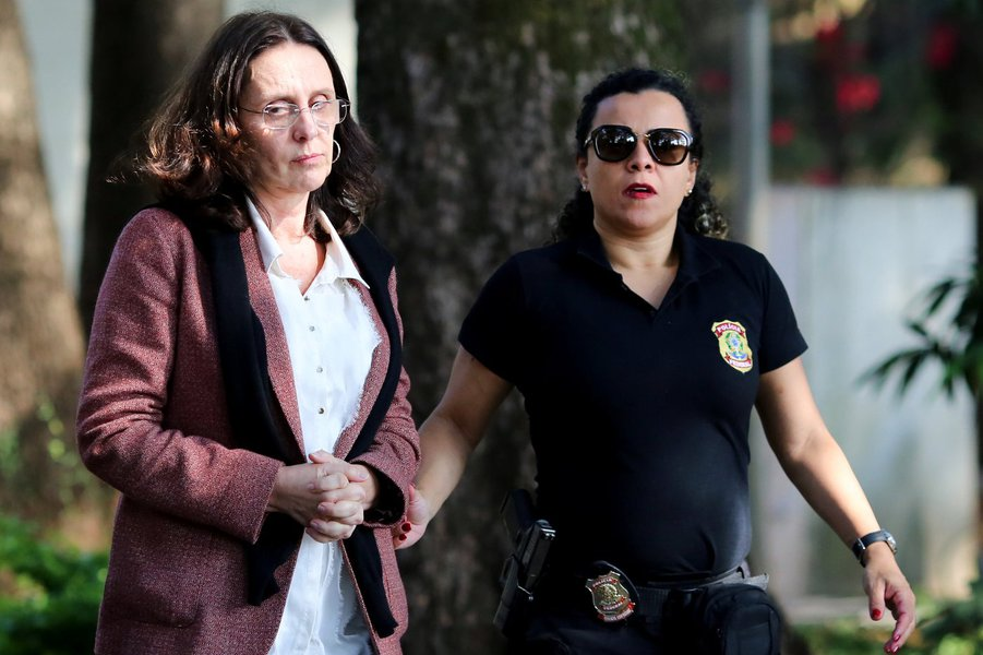 Andrea Neves, sister of Brazilian Senator Aecio Neves, is escorted by a federal police officer as she arrives to the Institute of Forensic Science in Belo Horizonte, Brazil, May 18, 2017. REUTERS/Cristiane Mattos