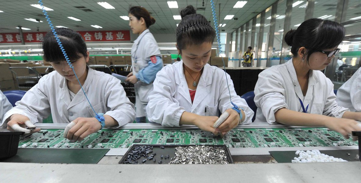 Chinese workers assembling circuit boards at a factory in Mianyang, southwest China's Sichuan province on April 30, 2012. China's manufacturing activity rose in April to a 13-month high, o