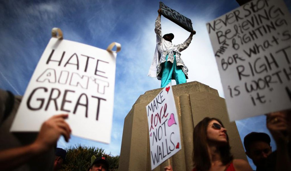 Reuters / Saturday, November 12, 2016 Protesters hold up signs during a march and rally against President-elect Donald Trump in Los Angeles, California.