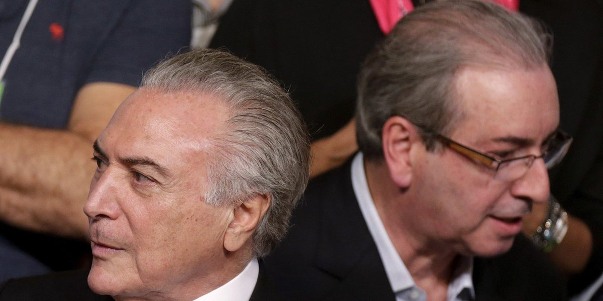 Brazil's Vice President Michel Temer (L) is seen near President of the Chamber of Deputies Eduardo Cunha during the Brazilian Democratic Movement Party (PMDB) national convention in Brasilia, Brazil, March 12, 2016. REUTERS/Ueslei Marcelino