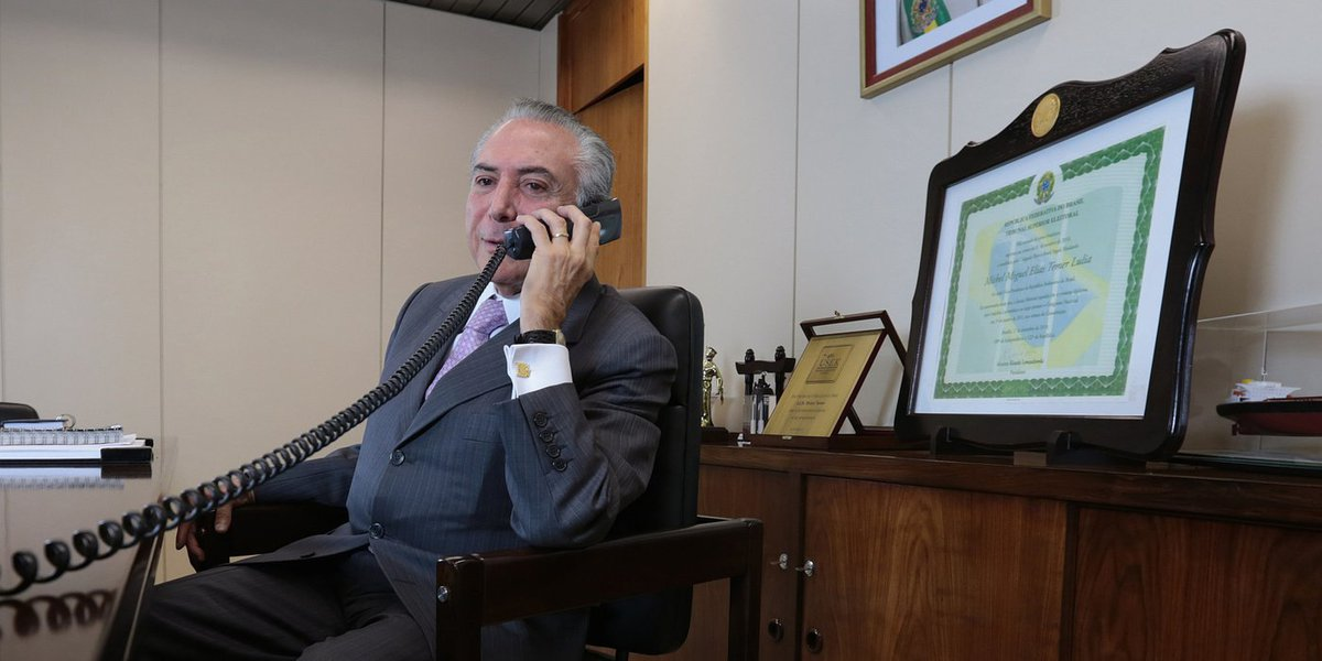 Brazil's Vice-President Michel Temer speaks on the phone in his office in Brasilia, July 23, 2014. REUTERS/Joedson Alves (BRAZIL - Tags: POLITICS)