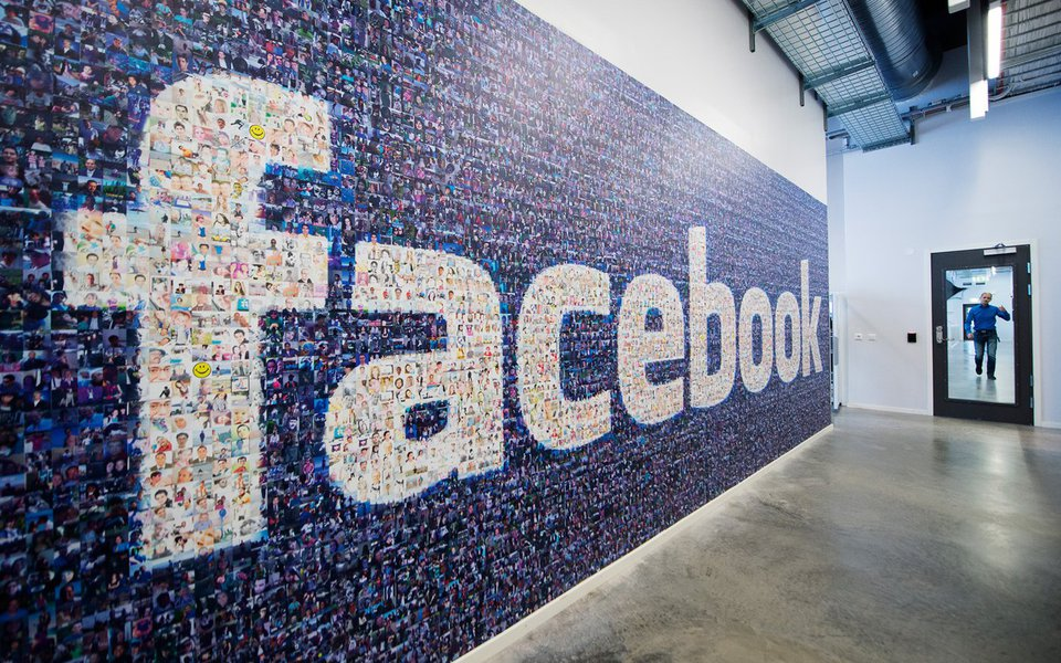 A big logo created from pictures of Facebook users worldwide is pictured in the company's Data Center, its first outside the US on November 7, 2013 in Lulea, in Swedish Lapland. The company began construction on the facility in October 2011 and went live