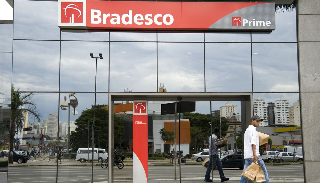A man walks past a Banco Bradesco SA branch Sao Paulo, Brazil, on Monday, Aug. 3, 2009. Bradesco, Brazil's second-largest non-government bank, said quarterly profit climbed 15 percent, helped by gains from the sale of its stake in a credit-card company an