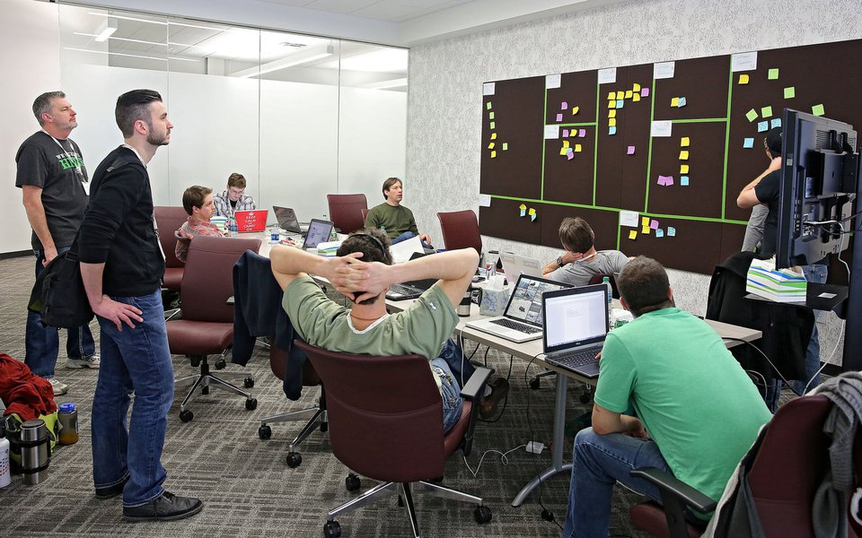 A team works on their project in a conference room during a Startup Weekend event at the Cedar Rapids Metro Economic Alliance in Cedar Rapids on Saturday, March 1, 2014. (Stephen Mally/The Gazette-KCRG TV9)