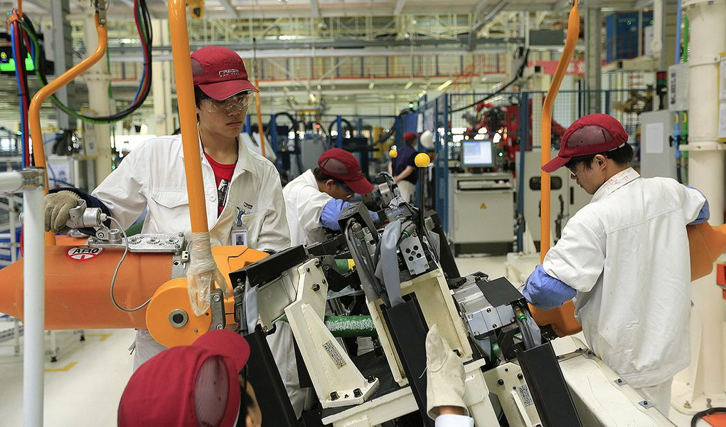 Employees at the Fiat SpA and Guangzhou Automobile Group Co. (GAC) manufacturing plant work on the production of Viaggio vehicles in Changsha, Hunan Province, China, on Thursday, June 28, 2012. Fiat, with two failed partnerships in China, returned to manu