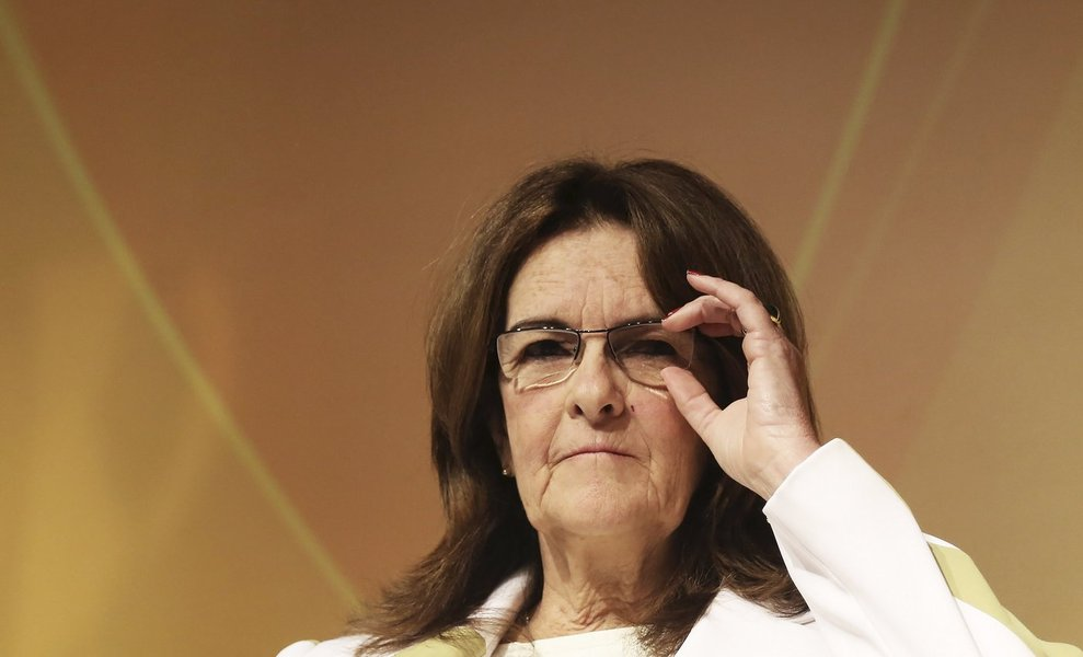 """Chief Executive Officer of Brazil's state oil company Petrobras Maria das Gracas Silva Foster adjusts her glasses as she talks to the audience during a conference about """"Building a better working World"""" in Sao Paulo October 24, 2013. Brazil's state-run oi"""
