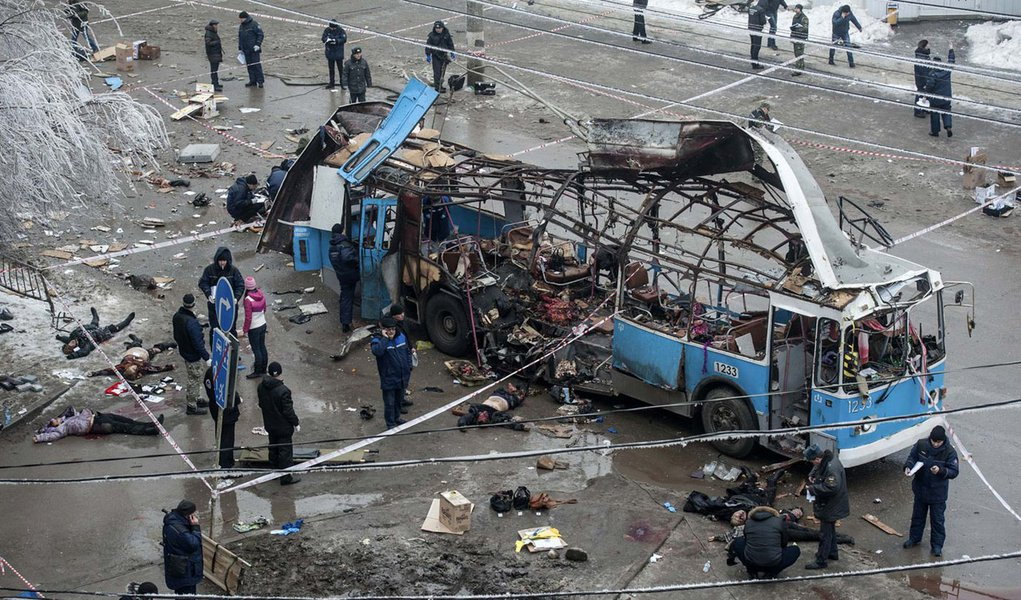 ATTENTION EDITORS - VISUAL COVERAGE OF SCENES OF INJURY OR DEATH  Investigators work at the site of a blast on a trolleybus in Volgograd December 30, 2013. A bomb blast ripped a trolleybus apart in Volgograd on Monday, killing 14 people in the second de