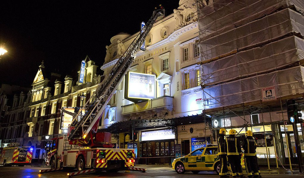 Emergency services look at the roof of the Apollo Theatre on Shaftesbury Avenue after part of the ceiling collapsed in central London December 19, 2013.  Emergency services said nearly 90 people had been injured in a packed London theatre on Thursday when