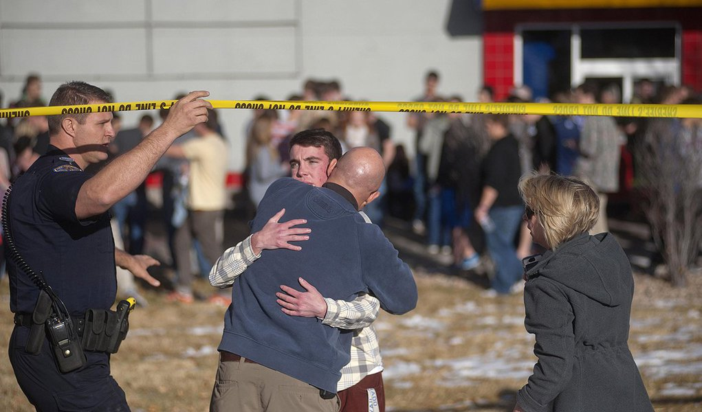 Students gather and reunite with their parents at a fast food joint across from Arapahoe High School, after a student opened fire in the school in Centennial, Colorado December 13, 2013. The student seeking to confront one of his teachers opened fire at t