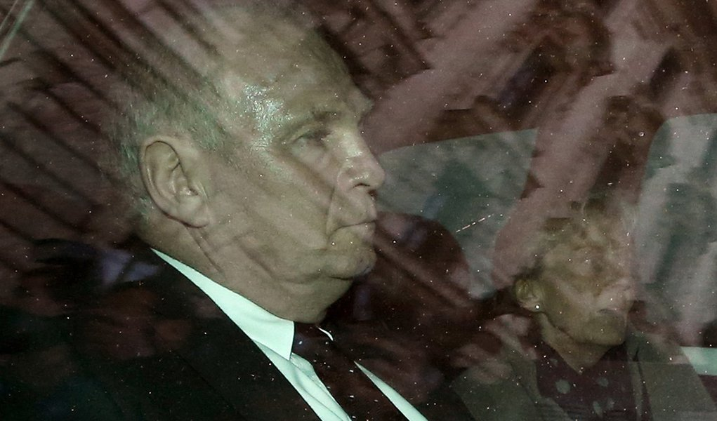 Bayern Munich President Uli Hoeness and his wife Susi leave by car following the verdict in his trial for tax evasion at the regional court in Munich March 13, 2014. A German court convicted Hoeness of tax evasion on Thursday and sentenced the soccer boss