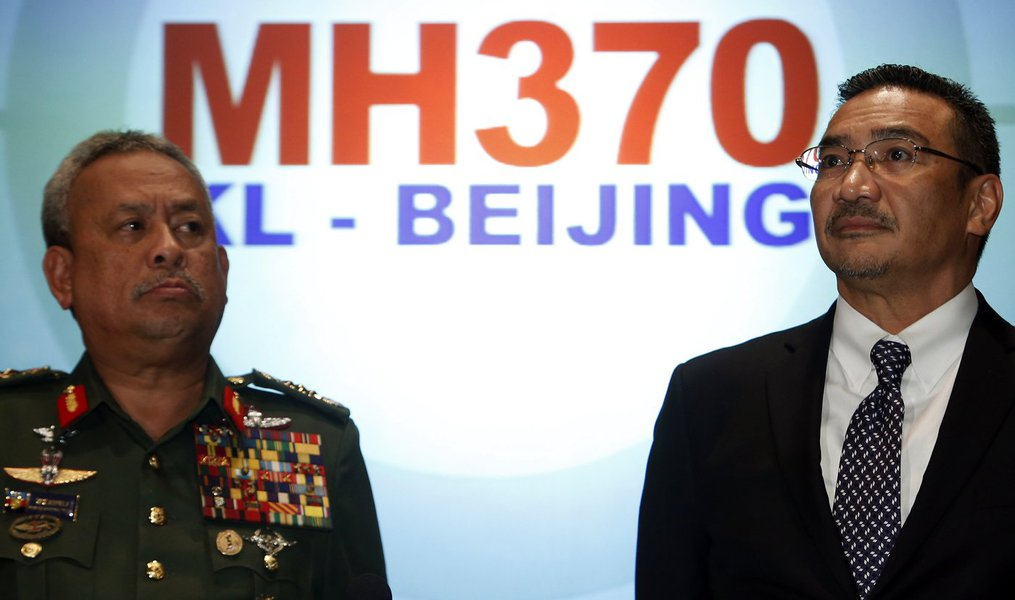 Malaysia's acting Transport Minister Hishammuddin Hussein listens to questions next to Chief of Armed Forces General Zulkifeli Mohd. Zin (L) during a news conference about the missing Malaysia Airlines MH370 plane at Kuala Lumpur International Airport Mar