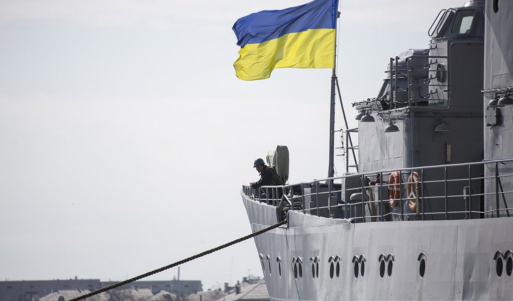 Ukrainian Navy sailors stand guard on the Ukrainian navy command ship Slavutych at the Crimean port of Sevastopol March 18, 2014. Putin, defying Ukrainian protests and Western sanctions, on Tuesday signed a treaty making Crimea part Russia but said he did