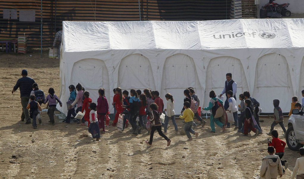 Syrian refugee children walk together to receive their polio vaccine during a vaccination campaign at a Syrian refugee camp near Zahle town in the Bekaa Valley November 8, 2013. Lebanon launched a massive public health initiative on Friday to vaccinate al