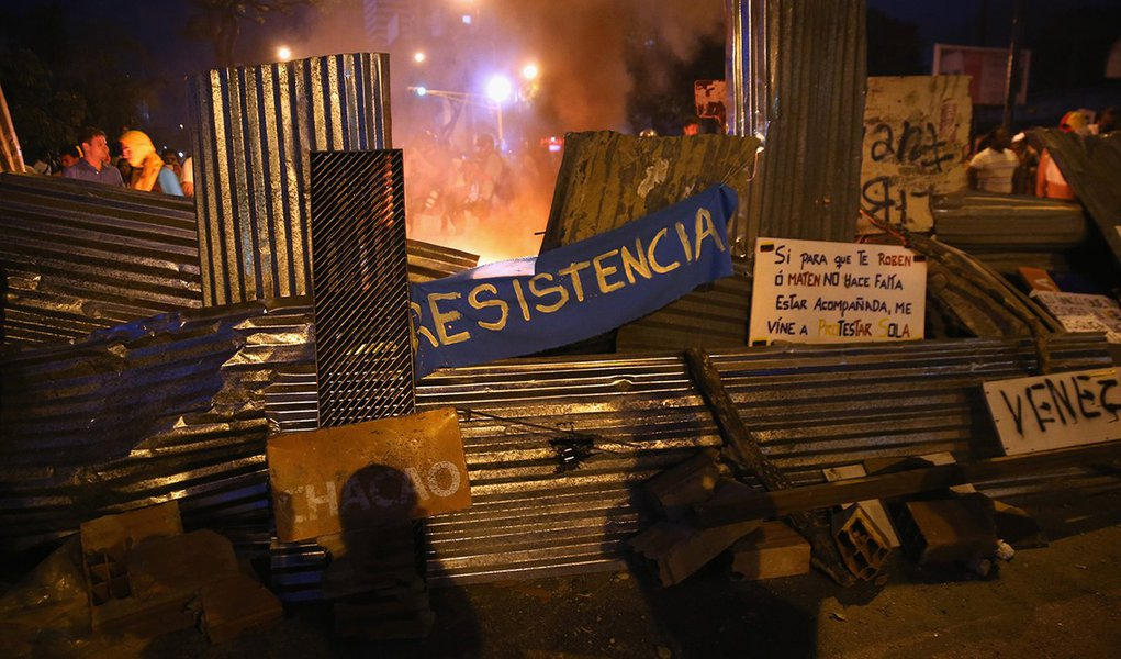 CARACAS, VENEZUELA - MARCH 02:  A fire burns behind a barricade during an anti-government demonstration on March 2, 2014 in Caracas, Venezuela. With one of the highest inflation rates in the world, Venezuela has been in turmoil for almost three weeks as o