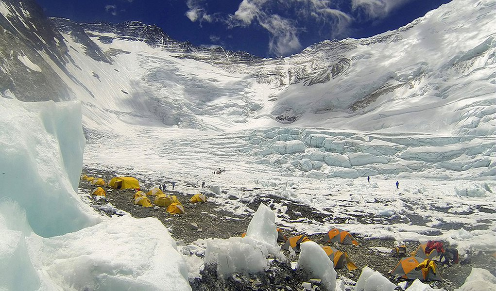 In this Tuesday, May 16, 2013 photo, tents are pitched on Camp 2, as climbers rest on their way to summit the 8,850-meter (29,035-foot) Mount Everest. May is the most popular month for Everest climbs because of more favorable weather. Earlier this month,