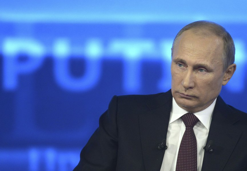 Russian President Vladimir Putin takes part in a live broadcast nationwide phone-in in Moscow April 17, 2014. Edward Snowden, the fugitive former U.S. spy agency contractor who leaked details of U.S. intelligence eavesdropping, asked Putin a question on T