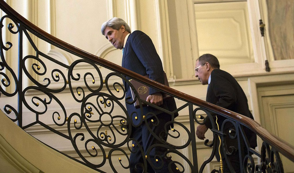 U.S. Secretary of State John Kerry, trailed by Russian Foreign Minister Sergei Lavrov, ascends the steps of the Russian Ambassador's Residence for their meeting  in Paris, March 5, 2014. Russia rebuffed Western demands to withdraw forces in Ukraine's Crim