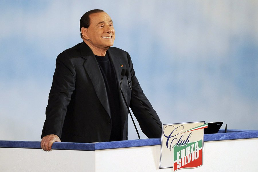 """Former Italian Prime Minister Silvio Berlusconi reacts as he attends a rally to launch the """"Forza Silvio"""" (Go Silvio) club in downtown Rome December 8, 2013. REUTERS/Yara Nardi (ITALY - Tags: POLITICS)"""