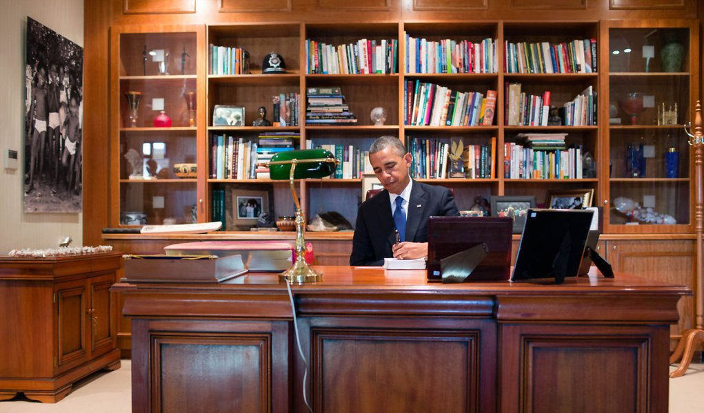 "President Barack Obama signs a copy of  former South African President Nelson Mandela's book ""Conversations with Myself"" while visiting Mandela's office at the Nelson Mandela Centre of Memory in Johannesburg, South Africa, June 29, 2013. President Obama w"