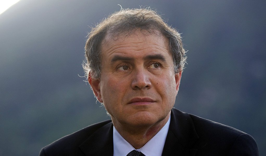 Nouriel Roubini, co-founder and chairman of Roubini Global Economics LLC, pauses during a television interview at the Ambrosetti Workshop in Cernobbio, near Como, Italy, on Friday, March 30, 2012. The two day workshop brings together politicians, company