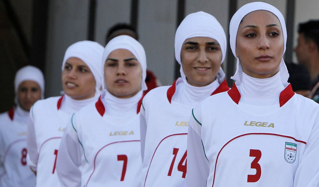 The Iranian women's national soccer team walk to the pitch before withdrawing from their qualifying match against Jordan for the 2012 London Olympic Games in Amman June 3, 2011. The Iranian team were banned from the match on Friday in the second round of