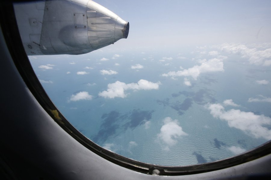 Clouds hover outside the window of a Vietnam Air Force search and rescue aircraft An-26 on a mission to find the missing Malaysia Airlines flight MH370, off Vietnam's Tho Chu island March 10, 2014. The disappearance of a Malaysian airliner about an hour i