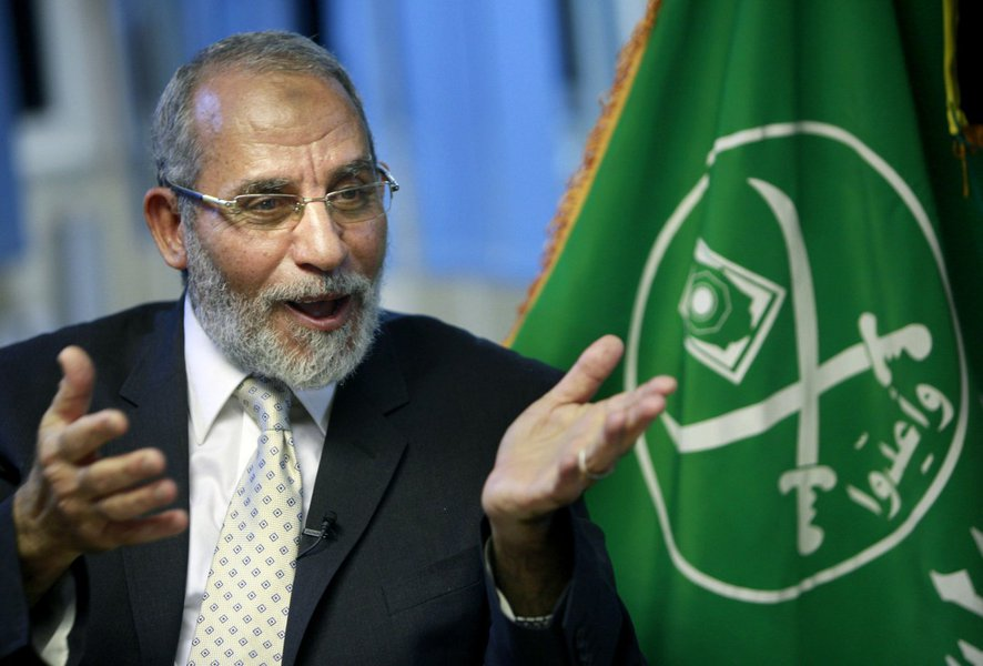 FILE - In this Tuesday, Oct. 26, 2010 file photo, Muslim Brotherhood supreme leader Mohammed Badie talks during an interview with the Associated Press at his office in Cairo Egypt. Egyptian security officials say the Muslim Brotherhood's supreme leader ha