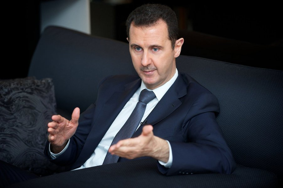 Syria's president Bashar al-Assad gestures during an interview with French daily Le Figaro in Damascus in this handout distributed by Syria's national news agency SANA on September 2, 2013.  REUTERS/SANA/Handout (SYRIA - Tags: CONFLICT CIVIL UNREST POLITI