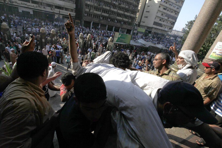An injured supporter of ousted Egyptian President Mohamed Mursi is carried into a mosque in Ramses Square in Cairo August 16, 2013. Protests by supporters of ousted Islamist President Mohamed Mursi turned violent across Egypt on Friday, with witnesses rep