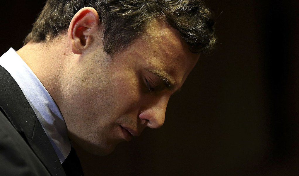 Olympic and Paralympic running star Oscar Pistorius reacts ahead of court proceedings at the Pretoria Magistrates court, August 19, 2013. The trial of Pistorius, accused of murdering his model girlfriend, will start on March 3 next year in a South African