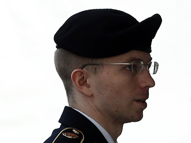 U.S. soldier Bradley Manning is escorted into court to receive his sentence at Fort Meade in Maryland August 21, 2013. Manning, who was convicted of the biggest breach of classified data in the nation's history, will be told on Wednesday how much of his l