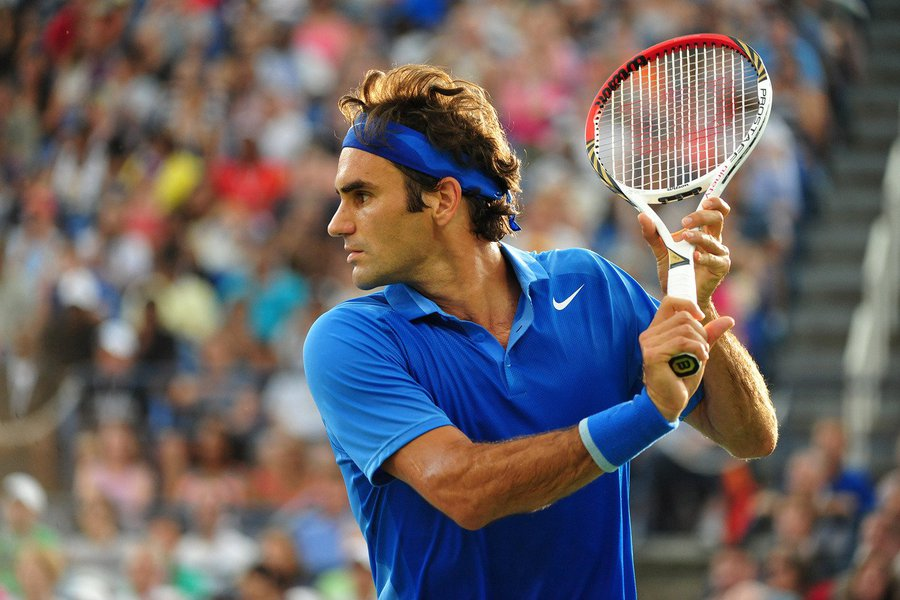 Roger Federer during his fourth round encounter against Tommy Robredo on Louis Armstrong Stadium.