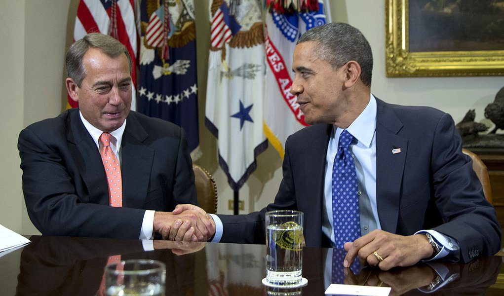 FILE - This Nov. 16, 2012 file photo shows President Barack Obama shaking hands with House Speaker John Boehner of Ohio in the Roosevelt Room of the White House in Washington, during a meeting to discuss the deficit and economy. Congress and the White Hou