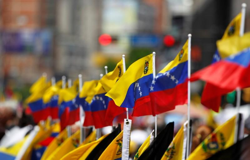 Venezuelan flags are seen during an opposition rally in Caracas, Venezuela, April 8, 2017. REUTERS/Christian Veron - RTX34Q8A