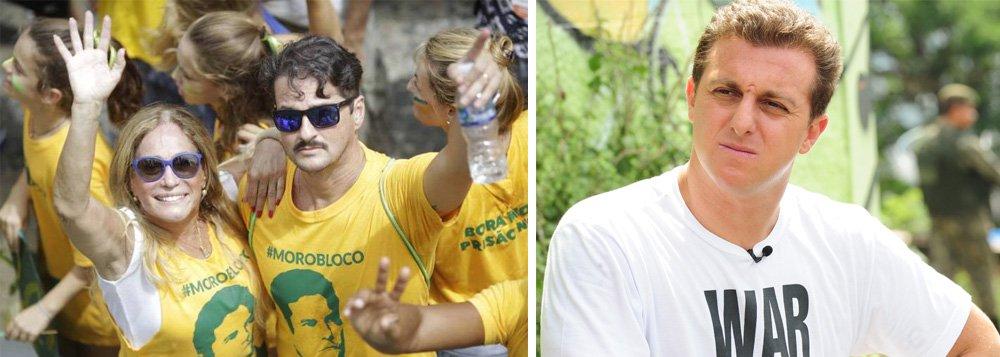 """O ator que interpretou o juiz Sergio Moro no filme da Lava Jato e foi presença constante nos protestos de 2016 contra Dilma Rousseff foi direto: """"Eu não votaria [em Huck]. Política eu não falo mais. Mas não, eu não votaria. Acho que tem pessoas mais preparadas, cara, tem pessoas que estão aí há um tempo já. É complicado. É um momento triste"""", disse Marcelo Serrado; sobre os """"Manifestoches"""", retratados pela Tuiuti, Serrado diz que foi """"genial""""; """"É a irreverência. Acho que tem que fazer de todos [os políticos], né? Não dá pra acreditar em nenhum hoje em dia"""""""