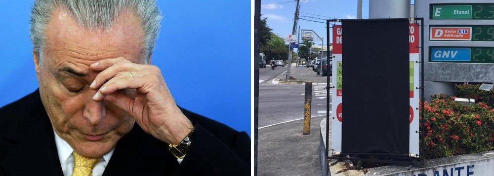 """Em protesto contra o anúncio, pelo governo Temer, do aumento da alíquota do PIS e Cofins que incide sobre a gasolina, donos de postos de combustíveis se organizam para colocar faixas pretas nas bombas de gasolina; o objetivo é caracterizar o """"luto"""" pela decisão"""