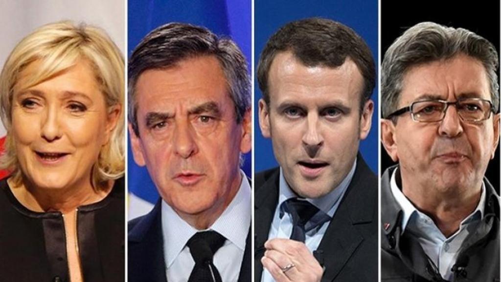 """Cerca de 47 milhões de franceses foram convocados para a primeiro turno da eleição presidencial neste domingo (22); diante da ameaça de atentados e três dias após um ataque visando policiais em pleno centro de Paris, um forte esquema de segurança foi montado; temendo novos ataques, as autoridades mobilizaram mais 50 mil policiais e agentes em todo o país, apoiados por 7 mil militares; """"Nada deve prejudicar o encontro democrático"""", afirmou o primeiro-ministro Bernard Cazeneuve; favoritos são Marine Le Pen, de 48 anos (Frente Nacional, extrema-direita), François Fillon, de 63 anos (Os Republicanos, direita), Emmanuel Macron, 39 anos (Em Marcha!, centro), Jean-Luc Mélenchon, 65 anos (França Insubmissa, esquerda radical)"""