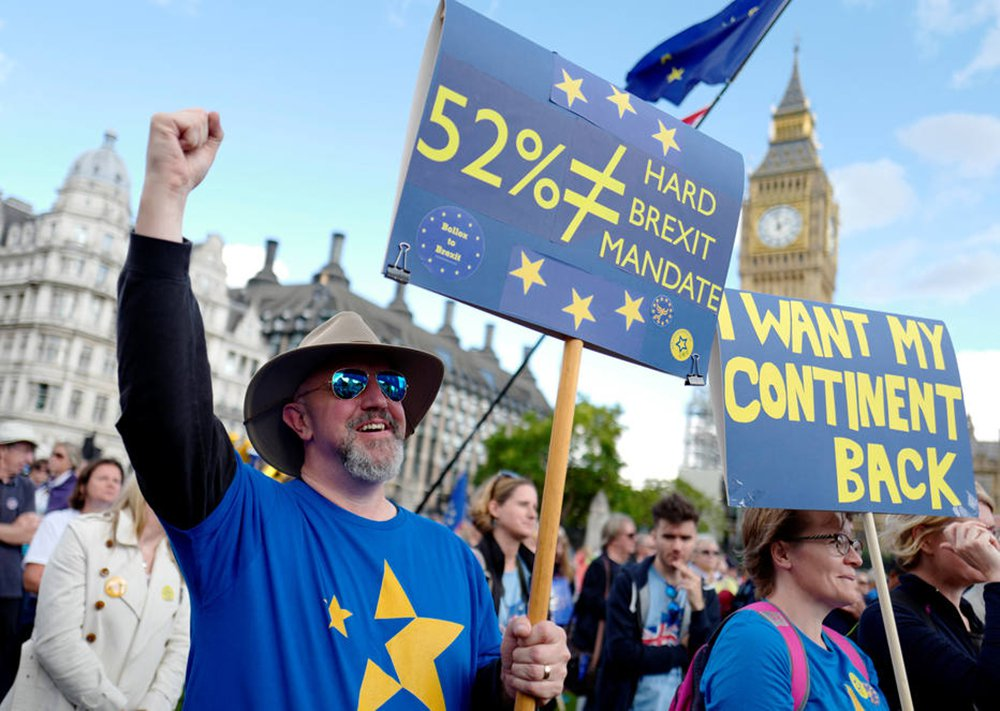 Demonstrators react in Parliament Square during the anti-Brexit 'People's March for Europe', in central London, Britain September 9, 2017. REUTERS/Tolga Akmen