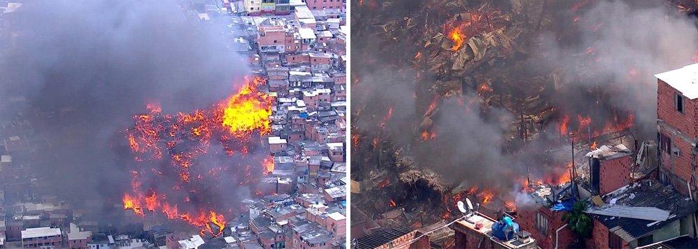 Um incêndio de grandes proporções atinge a comunidade de Paraisópolis, na zona sul da capital paulista; segundo o Corpo de Bombeiros, uma vítima foi socorrida por inalação de fumaça; de acordo com a corporação, cerca de 50 barracos foram atingidos