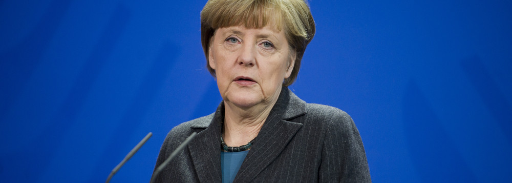 German Chancellor Angela Merkel addresses the media during a joint press conference as part of a meeting with Prime Minister of Singapore Lee Hsien Loong at the chancellery in Berlin, Germany, Tuesday, Feb. 3, 2015. (AP Photo/Steffi Loos)