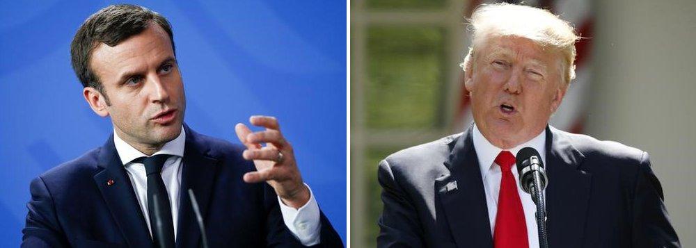 """Presidente da França, Emmanuel Macron, disse ao presidente dos Estados Unidos, Donald Trump, que o acordo climático de Paris não pode ser renegociado e que, embora a França continue a trabalhar com Washington, não mais discutiria assuntos climáticos com os EUA, disse uma fonte francesa; """"O presidente falou com o presidente Trump em um telefonema de cinco minutos"""", afirmou uma fonte próxima a Macron"""