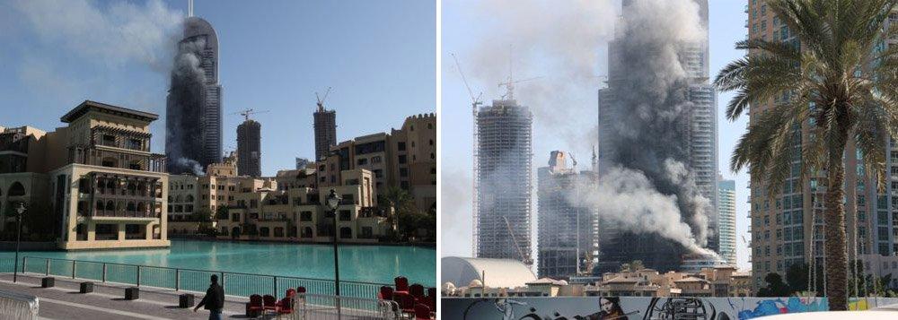 Bombeiros aparentemente apagaram a maior parte do fogo que repentinamente tomou conta de um dos arranha-céus mais importantes de Dubai durante a passagem do ano, segundo relataram testemunhas; a fumaça branca, no entanto, ainda sai da torre do hotel Address Downtown Dubai, cujo edifício tem 63 andares; equipes da defesa civil extinguiram a maior parte das chama; de acordo com a polícia de Dubai, o prédio foi esvaziado e que apenas 14 pessoas ficaram levemente feridas, mas um médico no local afirmou que 60 pessoas foram tratadas por inalação de fumaça e problemas causados pelo tumulto na tentativa de fugir do local