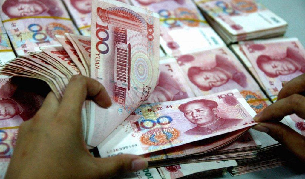 Banco Central da China revisou para baixo as projeções de crescimento da economia para o próximo ano; segundo a instituição, economia deve desacelerar para 6,8% 2016, contra 6,9% das projeções anteriores