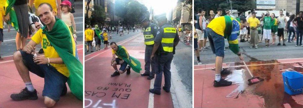 Manifestante em defesa do impeachment que posou para fotos enquanto pichava a ciclovia durante protesto contra o governo Dilma na Avenida Paulista foi obrigado pela Polícia Militar a lavar toda a sujeira