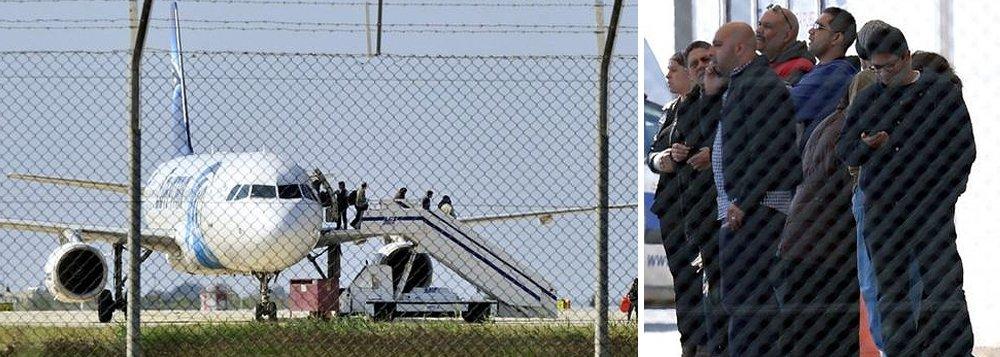 """O homem que desviou um avião do Egito para o Chipre foi detido pelas força de segurança locais; informação foi divulgada minutos depois de quatro das sete pessoas que o homem mantinha reféns terem abandonado a aeronave, três pela porta e outra pela janela da cabine dos pilotos; o Airbus A-320 da EgyptAir fazia a ligação entre Alexandria, no Norte do Egito, e o Cairo, e foi desviado para Larnaca, no Sul da ilha de Chipre; segundo o presidente de Chipre, Nicos Anastasiades, as motivações do sequestro ainda não são claras, mas """"não estão ligadas ao terrorismo"""""""