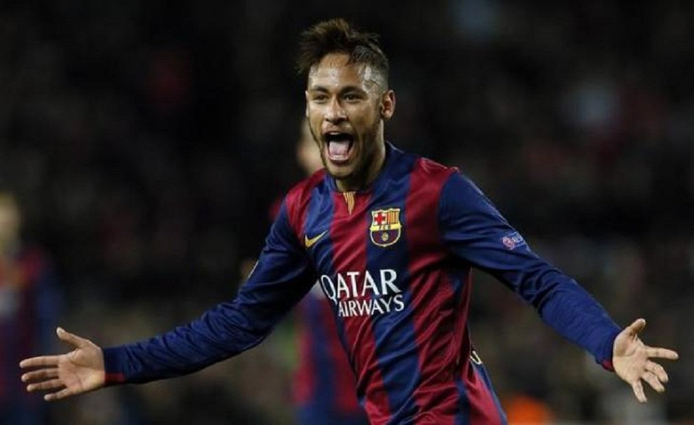 Barcelona's Neymar celebrates after scoring a goal against Paris St Germain during their Champions League Group F soccer match at the Nou Camp stadium in Barcelona, December 10, 2014. REUTERS/Albert Gea