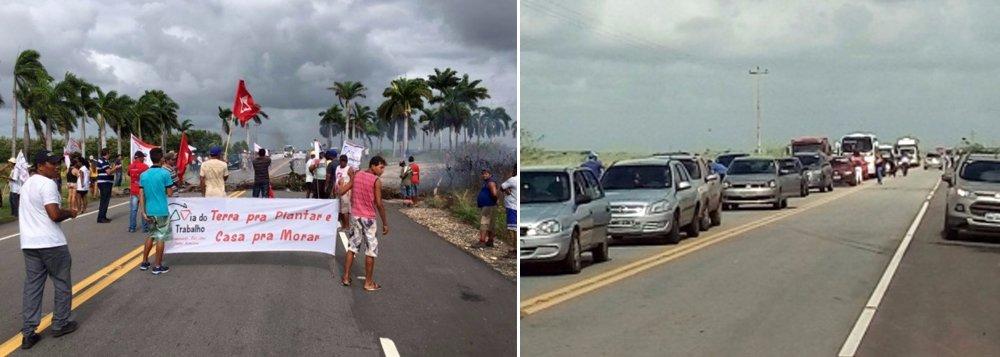 """Membros de diversos movimentos sociais, incluindo os sem-terra, bloqueiam cerca de 20 trechos de rodovias estaduais e federais em Alagoas com a justificativa de chamar a atenção para a violência no campo e, principalmente, em defesa da democracia; """"Parte dos que conduzem o golpe dentro do parlamento tiveram suas campanhas financiadas pelo agronegócio, o mesmo que continua matando trabalhadores e trabalhadoras rurais"""", disse Débora Nunes, da Coordenação Nacional do MST"""